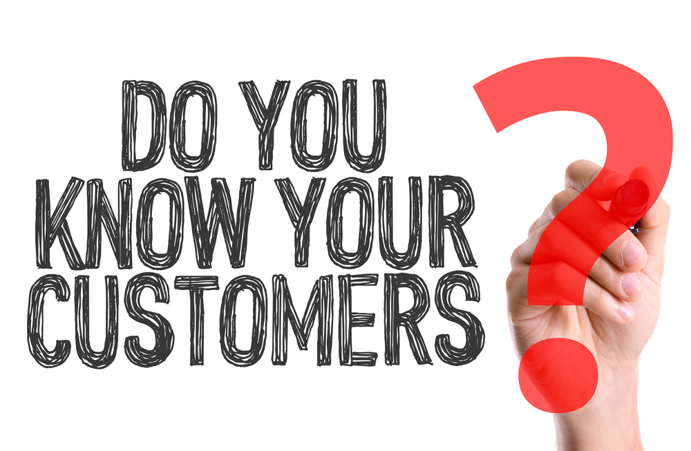 Hand with marker writing the word Do You Know Your Customers?
