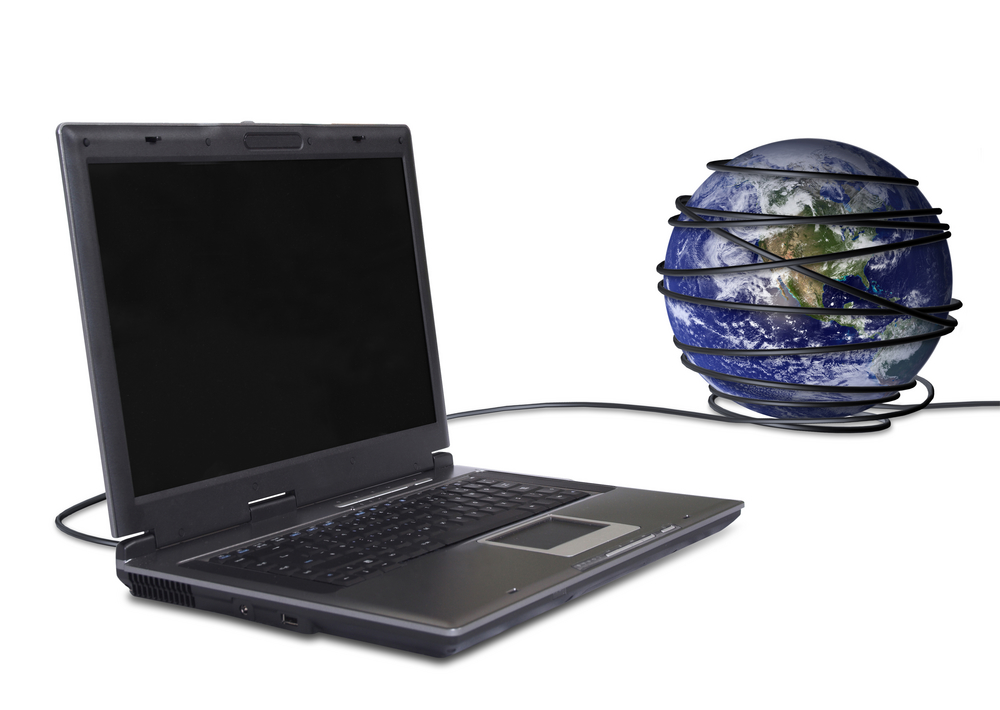 business laptop connected to the globe, online communications