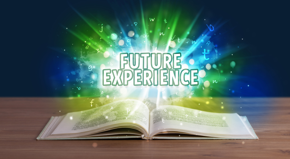 FUTURE EXPERIENCE inscription coming out from an open book, educational concept