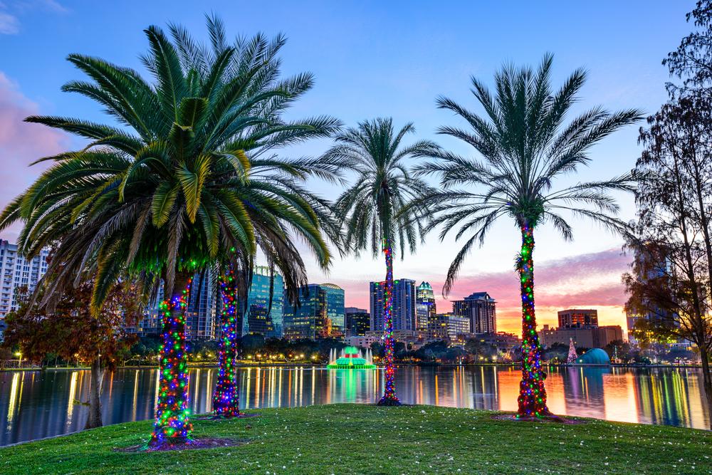 Orlando, Florida, USA downtown skyline at Eola Lake.